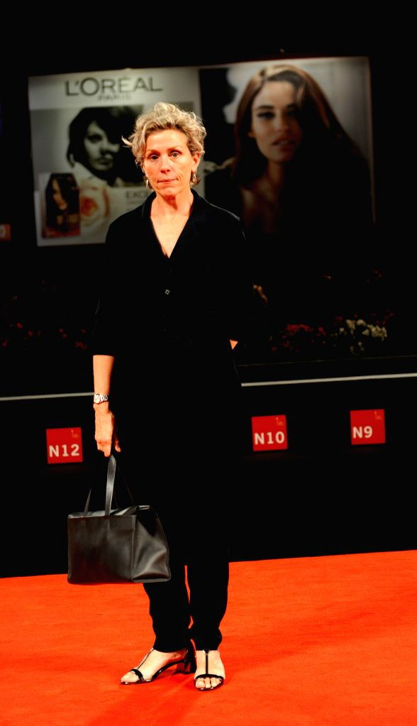 """Actress Frances McDormand poses on the red carpet for """"Olive Kitteridge"""" during the 71st Venice Film Festival, in Lido of Venice, Italy on Sept. 1, 2014. .. - Frances M"""