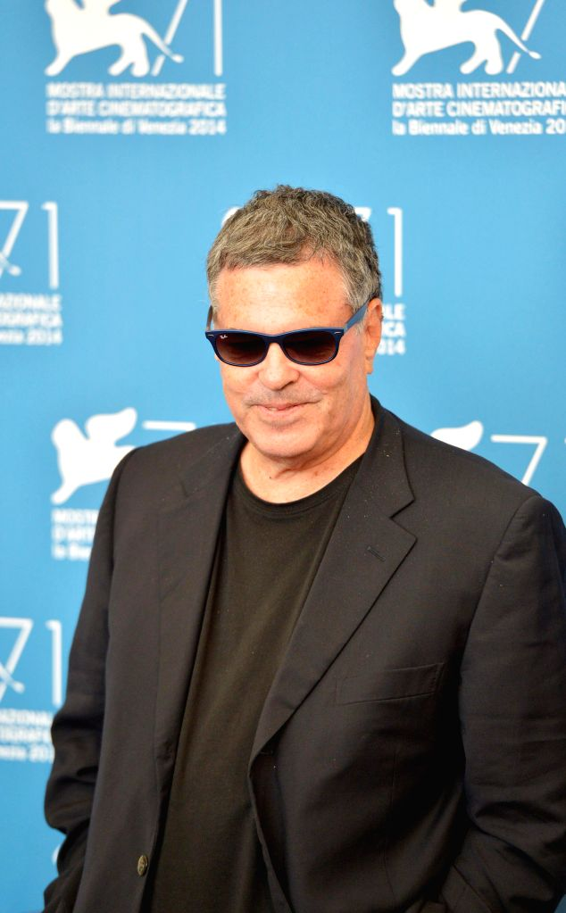 """Director Amos Gitai poses during the photo call for """"Tsili"""" which is selected for screening during the 71st Venice Film Festival, in Lido of Venice, Italy,"""
