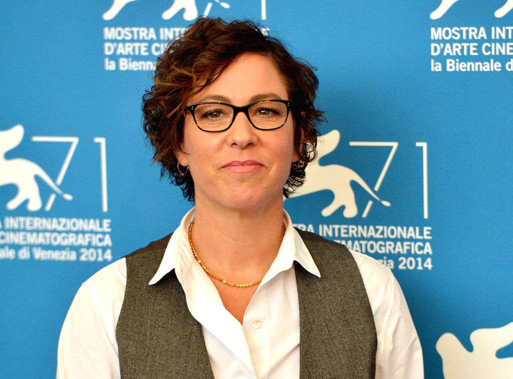 """Director Lisa Cholodenko poses during the photo call for """"Olive Kitteridge"""" which is selected for screening during the 71st Venice Film Festival, in Lido .."""