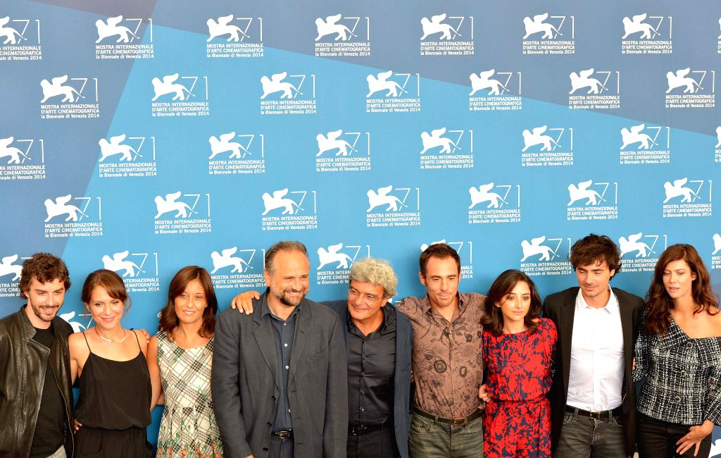 """Director Mario Martone (C) and cast members pose during the photo call for """"Il giovane favoloso"""" which is selected for the main competition during the 71st"""
