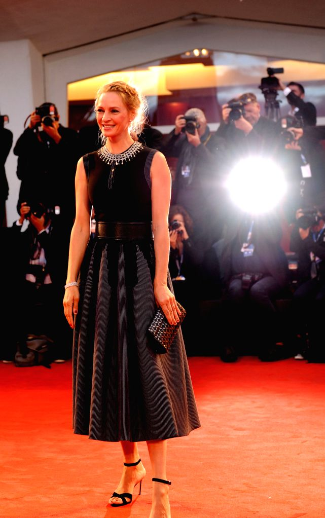 """US actress Uma Thurman poses on the red carpet for """"Il giovane favoloso"""" which is selected for the main competition during the 71st Venice Film Festival, .. - Uma Thurman"""