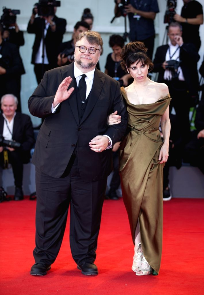 """VENICE, Sept. 1, 2017 - Actress Sally Hawkins (R) and director Guillermo Del Toro arrive for the premiere of the movie """"The Shape of Water"""" at the 74th Venice Film Festival in Venice, ... - Sally Hawkins"""