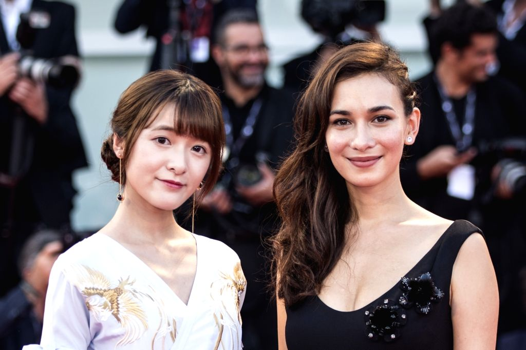 """VENICE, Sept. 1, 2017 - Actresses Xu Jiao (L) and Celina Jade arrive for the premiere of the movie """"The Shape of Water"""" at the 74th Venice Film Festival in Venice, Italy, on Aug. 31, 2017. - X"""