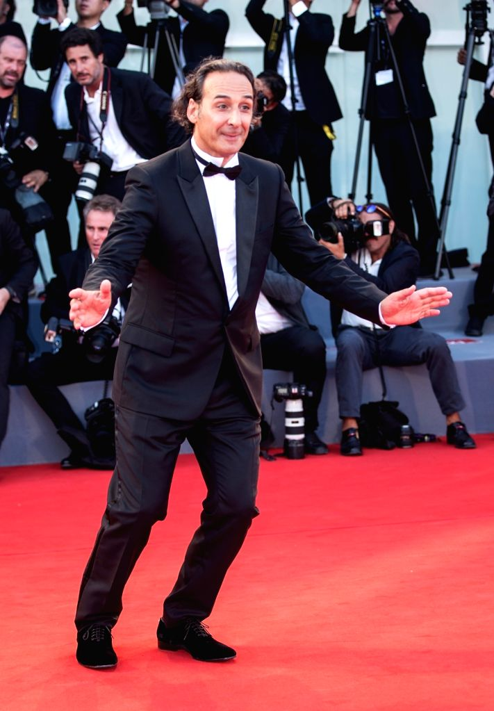 """VENICE, Sept. 1, 2017 - Composer Alexandre Desplat arrives for the premiere of the movie """"The Shape of Water"""" at the 74th Venice Film Festival in Venice, Italy, on Aug. 31, 2017."""