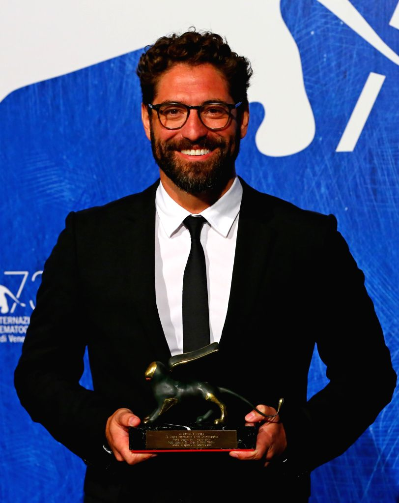 """VENICE, Sept. 11, 2016 - Actor Nuno Lopes poses with the Orizzonti Award for Best Actor for """"Saint George"""" during the award winners photocall of the 73rd Venice Film Festival in Venice, ... - Nuno Lopes"""