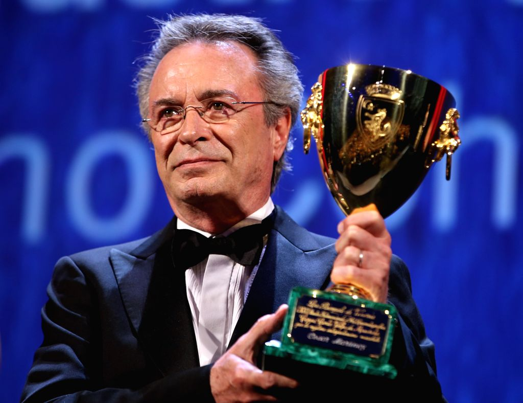"""VENICE, Sept. 11, 2016 - Actor Oscar Martinez holds the Coppa Volpi for the Best Actor for the movie """"El Ciudadano Ilustre""""  during the award ceremony at the 73rd Venice Film Festival, at ... - Oscar Martinez"""