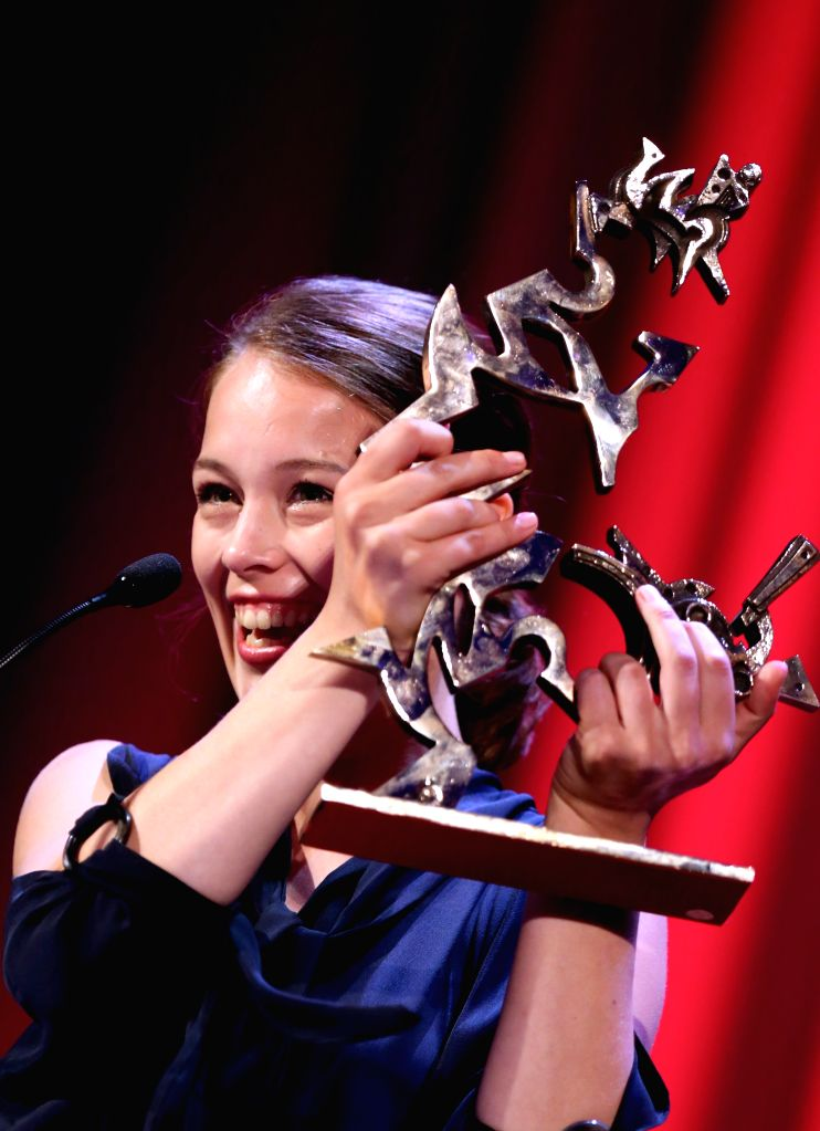 """VENICE, Sept. 11, 2016 - Actress Paula Beer poses with the Marcello Mastroianni Award to Best New Young Actress for her role in """"Frantz"""" during the award ceremony at the 73rd Venice Film ... - Paula Beer"""