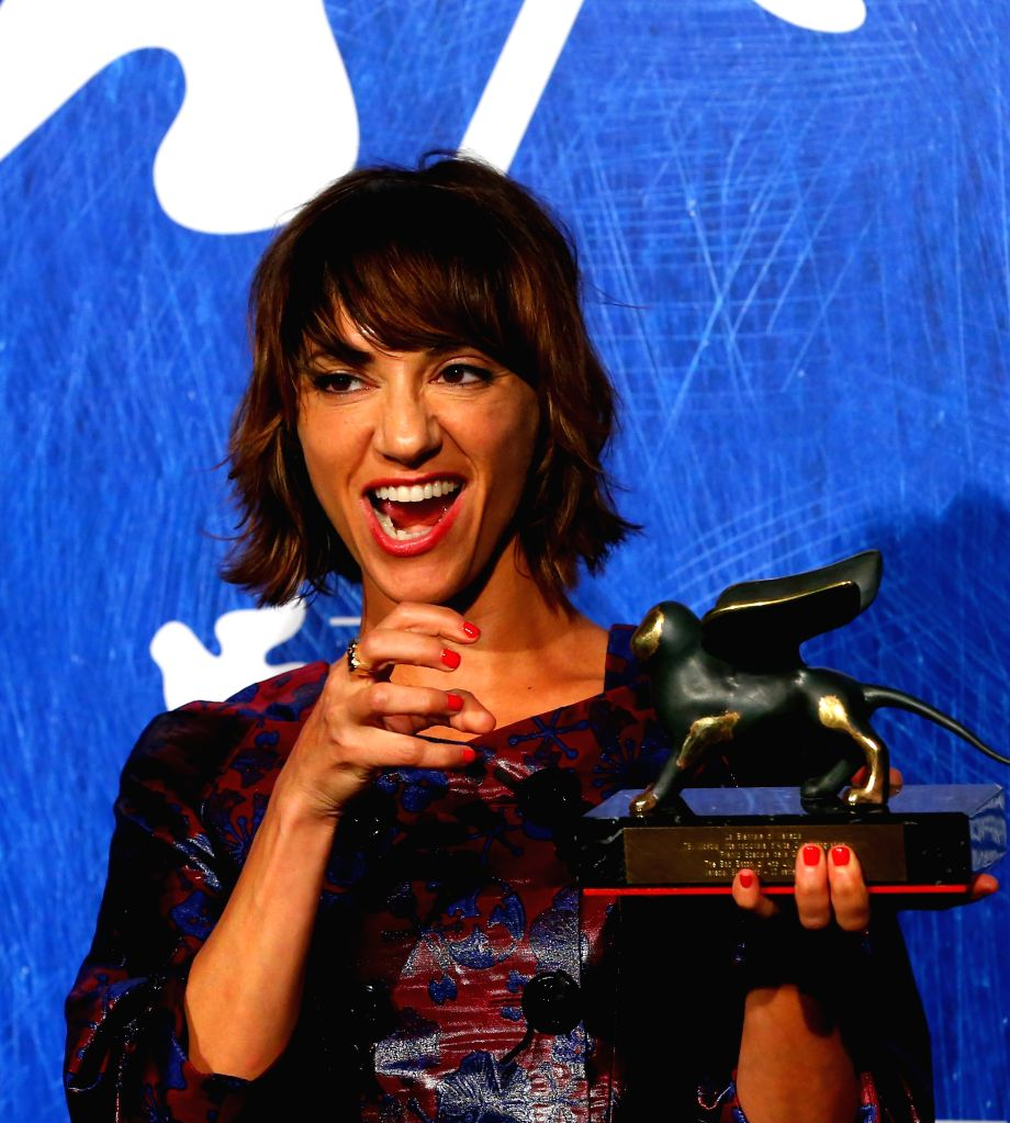 """VENICE, Sept. 11, 2016 - Director Ana Lily Amirpour poses with the Special Jury Prize for """"The Bad Batch"""" during the award winners photocall of the 73rd Venice Film Festival in Venice, ..."""