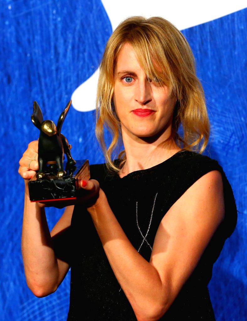 """VENICE, Sept. 11, 2016 - Director Fien Troch poses with the Orizzonti Award for Best Director for """"Home"""" during the award winners photocall of the 73rd Venice Film Festival in Venice, ..."""