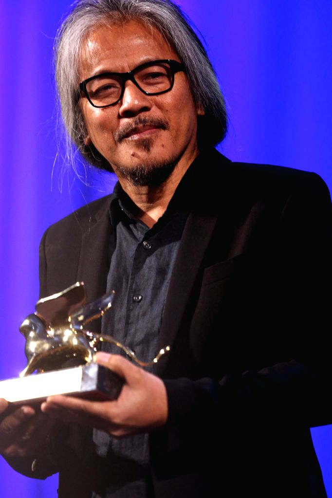 """VENICE, Sept. 11, 2016 - Director Lav Diaz holds the Golden Lion prize for his movie """"The Woman Who Left"""" during the award ceremony at the 73rd Venice Film Festival, at the Lido of Venice, ... - Lav Diaz"""