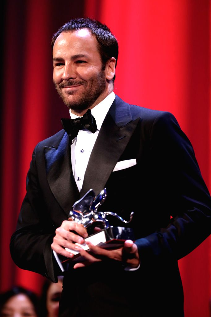"""VENICE, Sept. 11, 2016 - Director Tom Ford poses with the Grand Jury Prize for his movie """"Nocturnal Animals"""" during the award ceremony at the 73rd Venice Film Festival, at the Lido of ... - Lav Diaz"""
