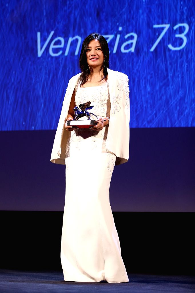 """VENICE, Sept. 11, 2016 - Member of the Jury, Chinese actress Zhao Wei gets ready to present the Silver Lion award for Best Director to director Andrei Konchalovsky for his movie """"Paradise"""" ... - Zhao Wei"""