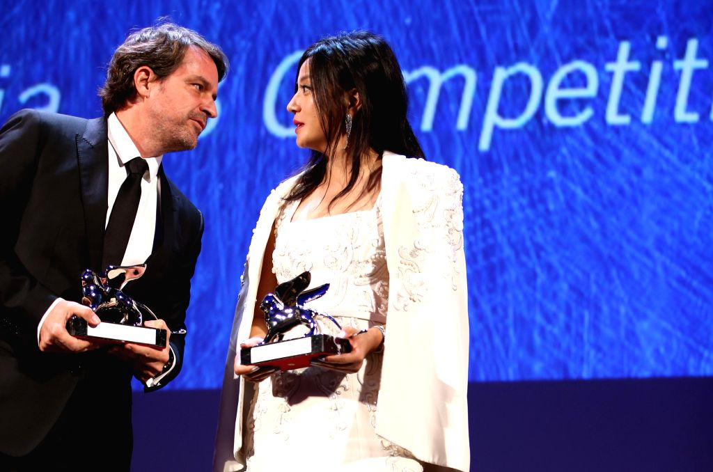 VENICE, Sept. 11, 2016 - Member of the Jury, Chinese actress Zhao Wei (R) talks to member of the Jury, Venezuelan director Lorenzo Vigas during the award ceremony at the 73rd Venice Film Festival, at ... - Zhao Wei
