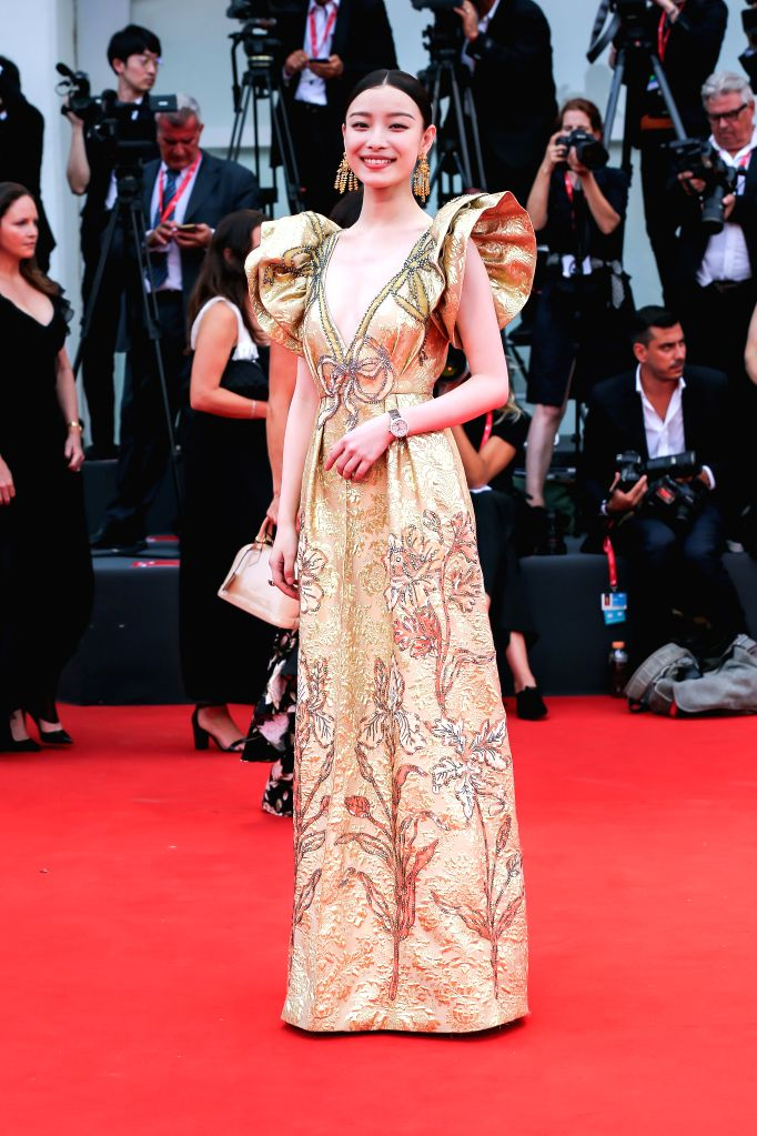 VENICE, Sept. 3, 2019 - Chinese actress Ni Ni poses on the red carpet during the 76th Venice International Film Festival in Venice, Italy, Aug. 28, 2019. Stars attend the event in high fashion ... - N