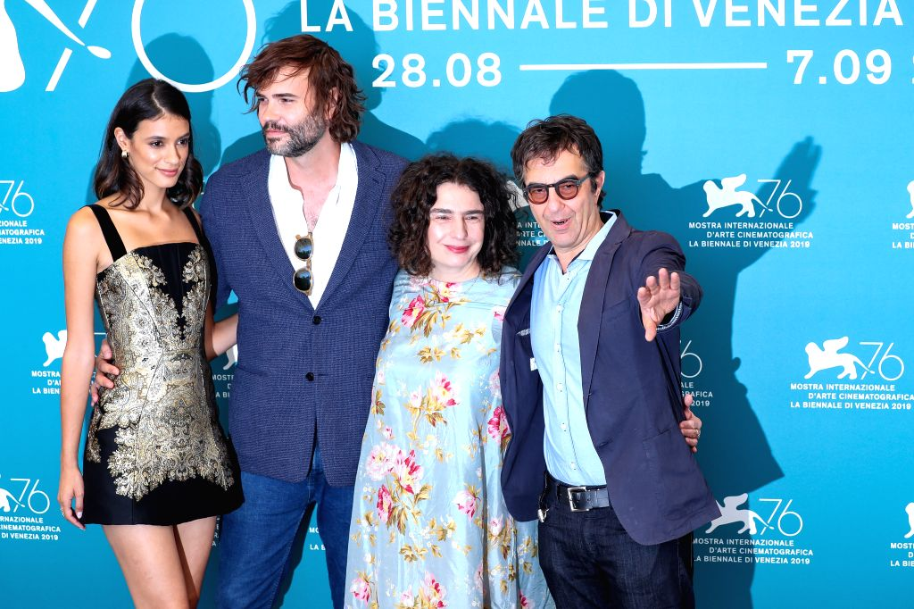 "VENICE, Sept. 3, 2019 - Director Atom Egoyan (1st R) and other cast members attend a photocall for the film ""Guest of Honour"" during the 76th Venice Film Festival in Venice, Italy, on Sept. ..."