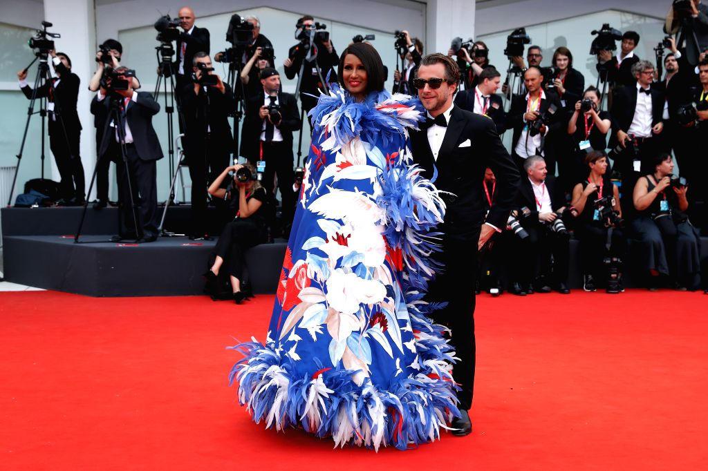 VENICE, Sept. 3, 2019 - Model and actress Zara Mohamed Abdulmajid (L), known as Iman, poses on the red carpet during the 76th Venice International Film Festival in Venice, Italy, Aug. 28, 2019. Stars ... - Zara Mohamed Abdulmajid