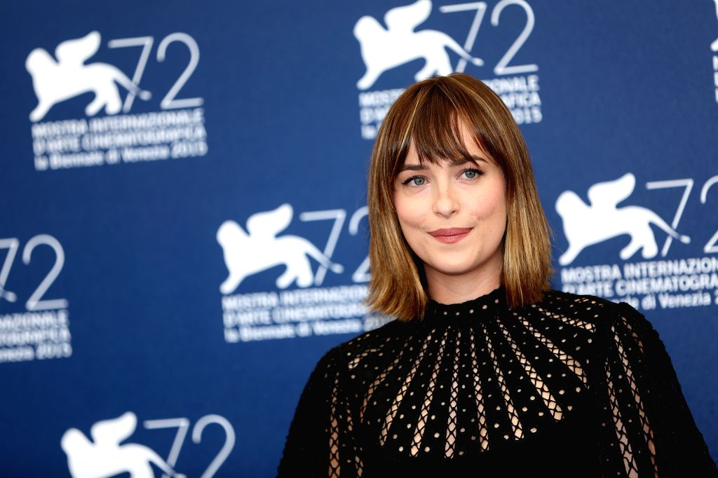 """VENICE, Sept. 4, 2015(Xinhua) -- Actress Dakota Johnson attends the photocall of the movie """"Black Mass"""" during the 72nd Venice Film Festival in Venice, Italy, on Sept. 4, 2015. (Xinhua/Jin Yu/IANS)(azp) - Dakota Johnson"""