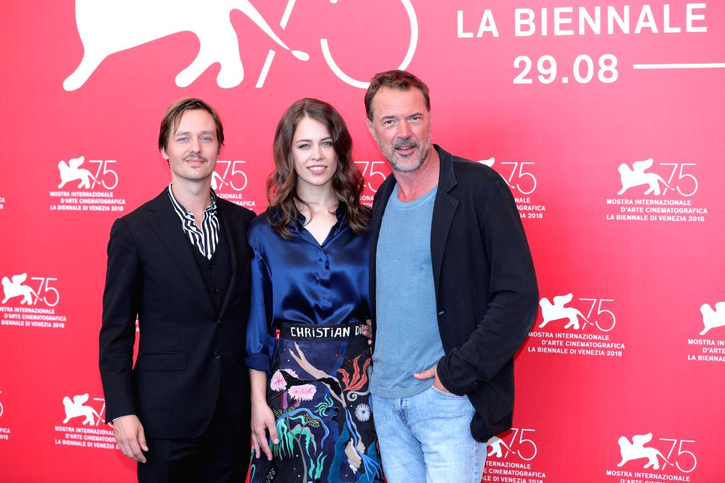 """VENICE, Sept. 4, 2018 - Actor Tom Schilling, actress Paula Beer and actor Sebastian Koch (L to R) attend """"Werk Ohne Autor"""" photocall during the 75th Venice International Film Festival in ... - Tom Schilling"""