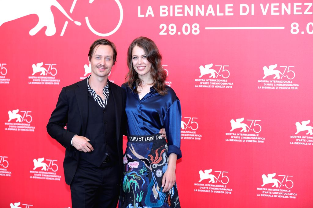 """VENICE, Sept. 4, 2018 - Actor Tom Schilling (L)  and actress Paula Beer attend """"Werk Ohne Autor"""" photocall during the 75th Venice International Film Festival in Venice, Italy, Sept. 4, 2018. - Tom Schilling"""