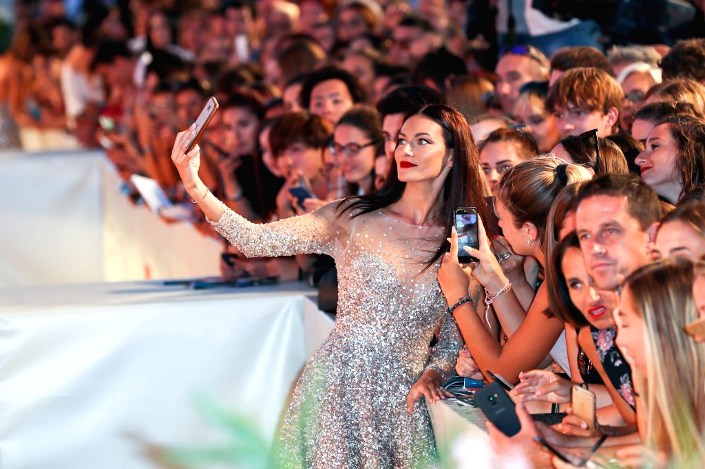 """VENICE, Sept. 4, 2019 - Model Paola Turani poses for a selfie with fans on the red carpet for the premiere of the film """"About Endlessness"""" during the 76th Venice International Film Festival ... - Paola Turani"""