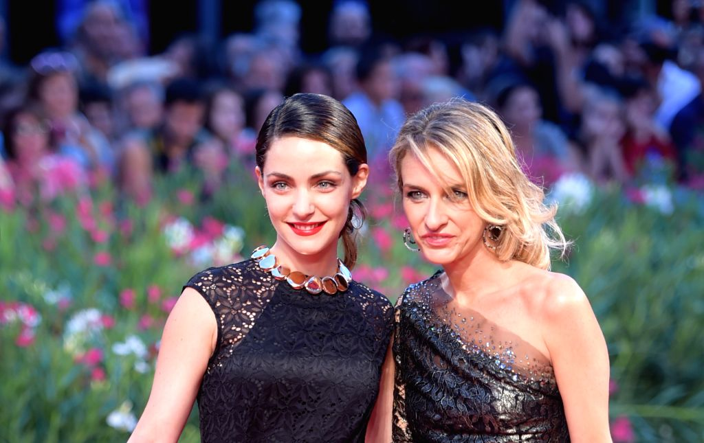 """Actress Valentina Corti (L) poses on the red carpet for """"Good Kill"""" which is selected for the main competition during the 71st Venice Film Festival, in ... - Valentina Corti"""