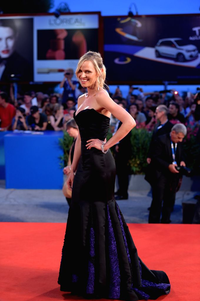 """Director Andrew Niccol's wife Rachel Roberts poses during the red carpet for """"Good Kill"""" which is selected for the main competition during the 71st Venice ."""
