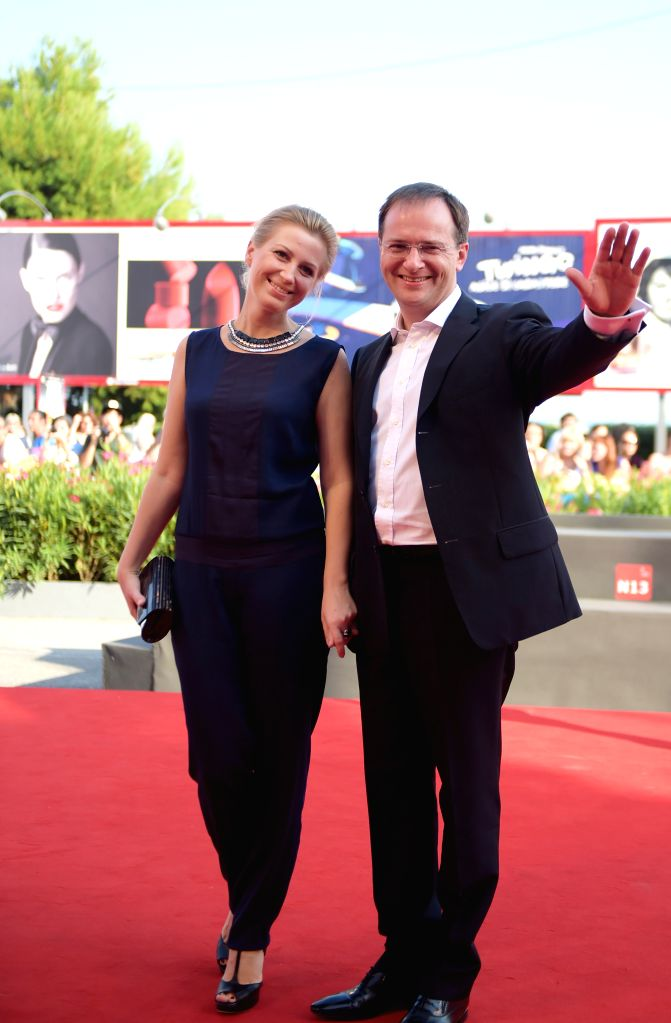 "Russian Culture Minister Vladimir Medinsky (R) poses on the red carpet for ""The postman's white nights"" which is selected in the competition unit  during .. - Vladimir Medinsky"