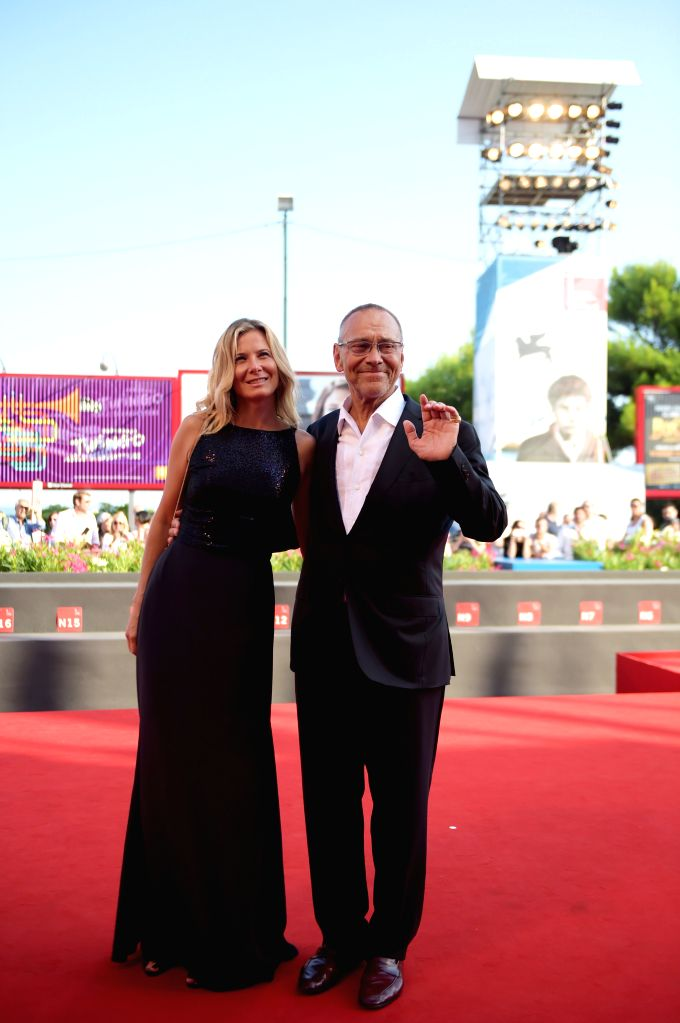 """Russian director Andrei Konchalovsky (R) poses on the red carpet for """"The postman's white nights"""" which is selected in the competition unit  during the ..."""