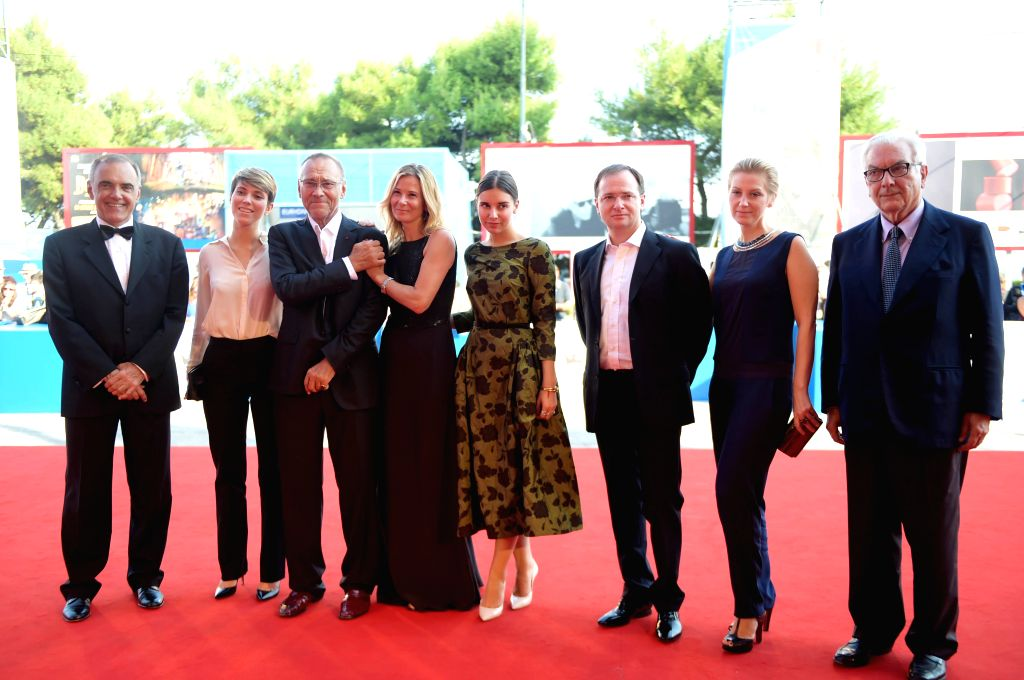 """Russian director Andrei Konchalovsky (3rd, L) poses on the red carpet for """"The postman's white nights"""" which is selected in the competition unit  during ..."""