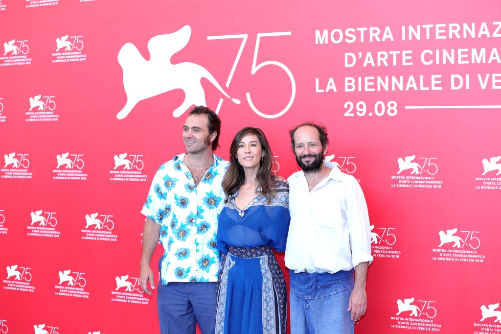 """VENICE, Sept. 5, 2018 - Actor Phil Burgers, actress Natalia Lopez and director Carlos Reygadas (L to R)  attend """"Nuestro Tiempo""""  photocall during the 75th Venice International Film ... - Phil Burgers"""
