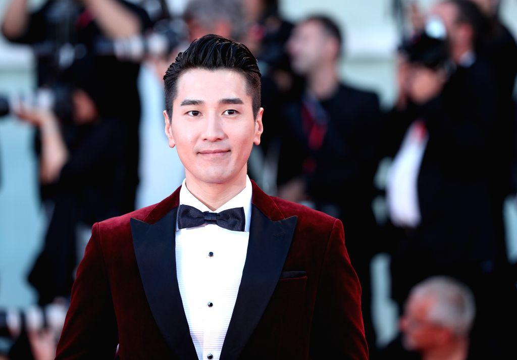 """VENICE, Sept. 5, 2019 - Chinese actor Mark Chao poses on the red carpet for the premiere of the film """"Saturday Fiction"""" during the 76th Venice International Film Festival in Venice, Italy, ... - Mark Chao"""