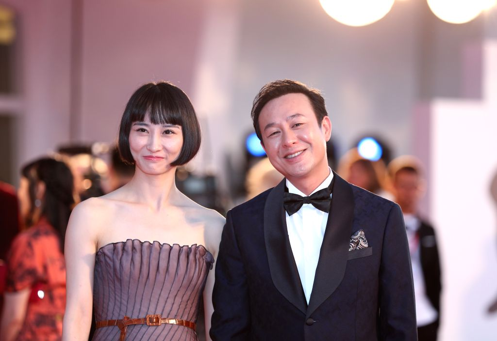 """VENICE, Sept. 5, 2019 - Chinese actress Huang Xiangli and actor Zhang Songwen pose on the red carpet for the premiere of the film """"Saturday Fiction"""" during the 76th Venice International ... - Huang Xiangli"""