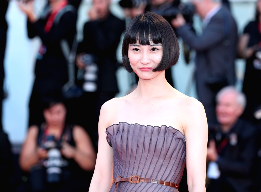 """VENICE, Sept. 5, 2019 - Chinese actress Huang Xiangli poses on the red carpet for the premiere of the film """"Saturday Fiction"""" during the 76th Venice International Film Festival in Venice, ... - Huang Xiangli"""