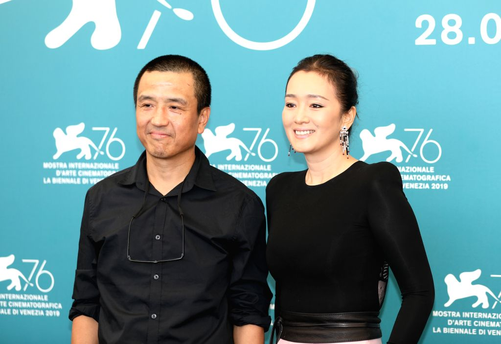 "VENICE, Sept. 5, 2019 - Chinese director Lou Ye (L) and actress Gong Li attend a photocall for the film ""Saturday Fiction"" at the 76th Venice Film Festival in Venice, Italy, Sept. 4, 2019. ... - Lou Y"