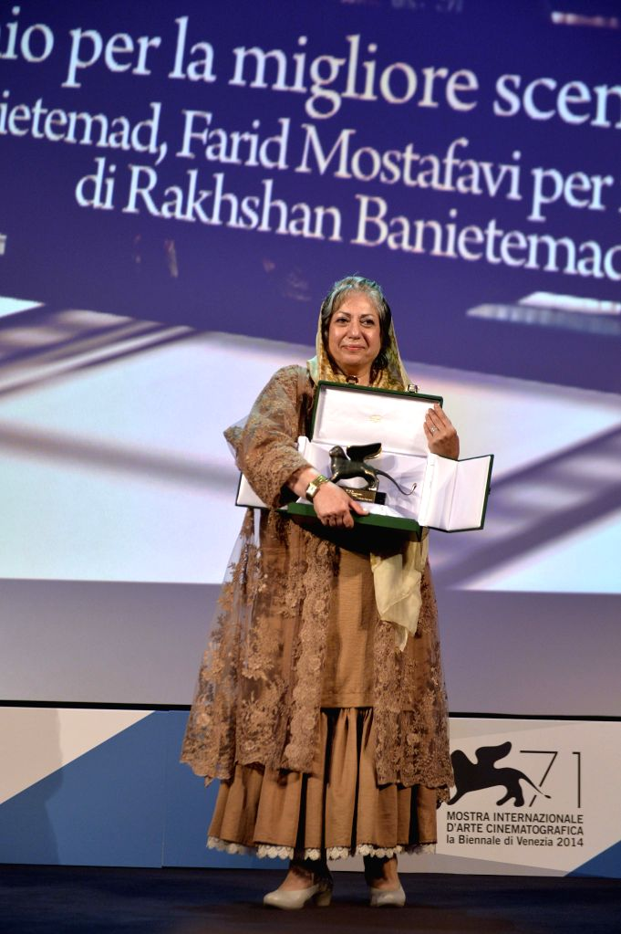 "Iranian screenwriter Rakhshan Banietemad poses with her trophy of the Best Screenplay award for her movie ""Ghesseha (Tales)"" during the awards ceremony at ."