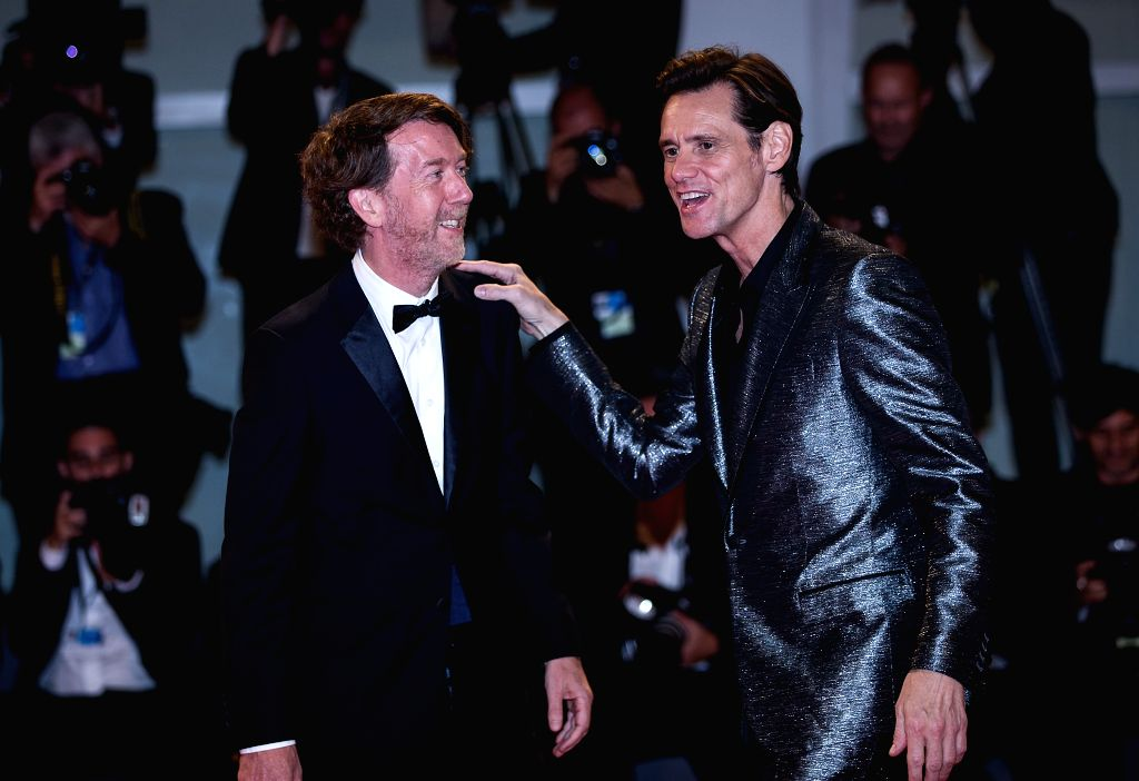 """VENICE, Sept. 6, 2017 - Actor Jim Carrey (R) and director Chris Smith attend the premiere of the movie """"Jim & Andy: The Great Beyond"""" at the 74th Venice Film Festival in Venice, Italy, ... - Jim Carrey"""