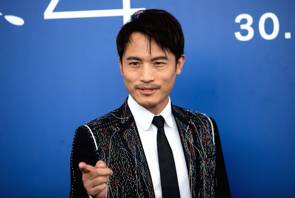 """VENICE, Sept. 7, 2017 - Actor Geng Le poses during a photocall for the movie """"Angels wear white"""" at the 74th Venice Film Festival in Venice, Italy, Sept. 7, 2017. - Geng L"""