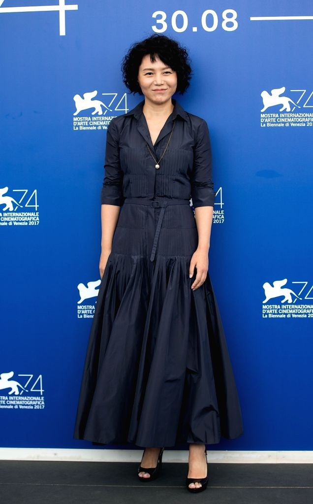 """VENICE, Sept. 7, 2017 - Director Vivian Qu poses during a photocall for the movie """"Angels wear white"""" at the 74th Venice Film Festival in Venice, Italy, Sept. 7, 2017."""