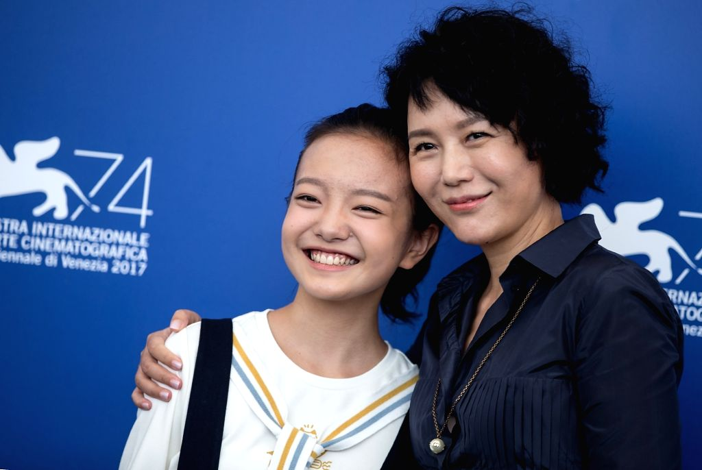 """VENICE, Sept. 7, 2017 - Director Vivian Qu (R) and actress Zhou Meijun pose during a photocall for the movie """"Angels wear white"""" at the 74th Venice Film Festival in Venice, Italy, Sept. 7, ... - Zhou Meijun"""