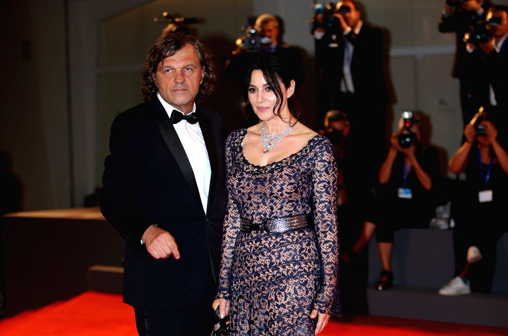 "VENICE, Sept. 9, 2016 - Director Emir Kusturica(L) and actress Monica Bellucci arrive for the premiere of the movie ""Na Mlijecnom Putu"" (On The Milky Road) at the 73rd Venice Film Festival ... - Monica Bellucci"