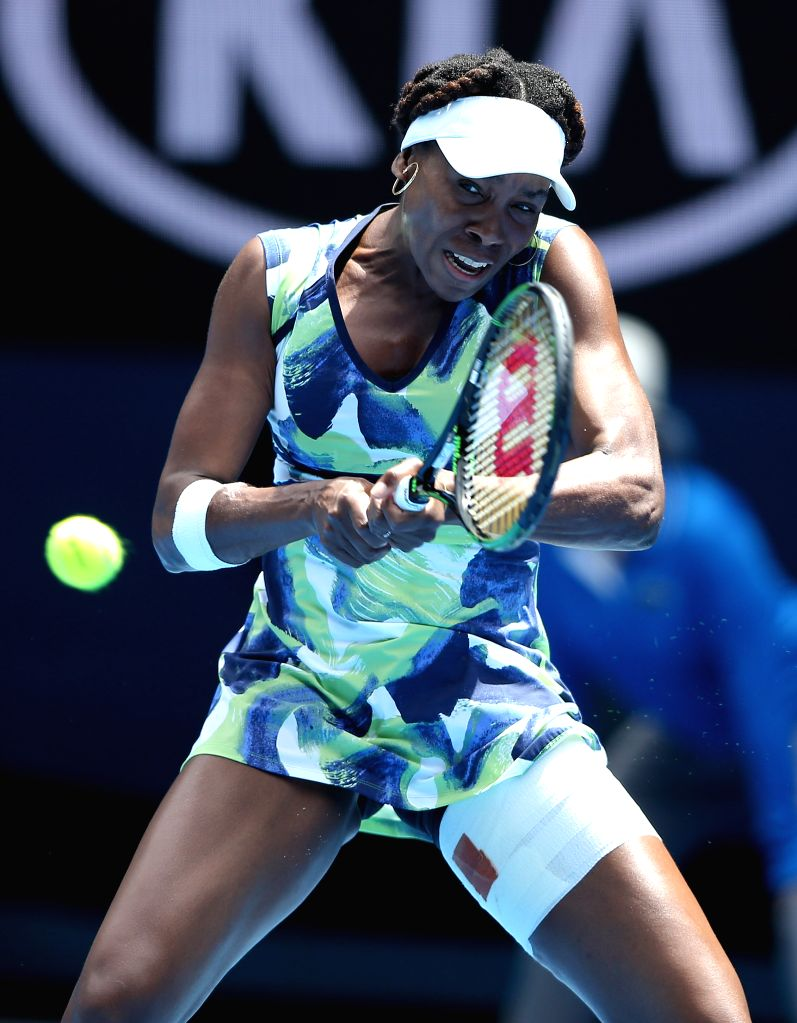 Venus Williams of the United States returns the ball against Johanna Konta of Great Britain during the first round match of women's singles at the Australian Open ...