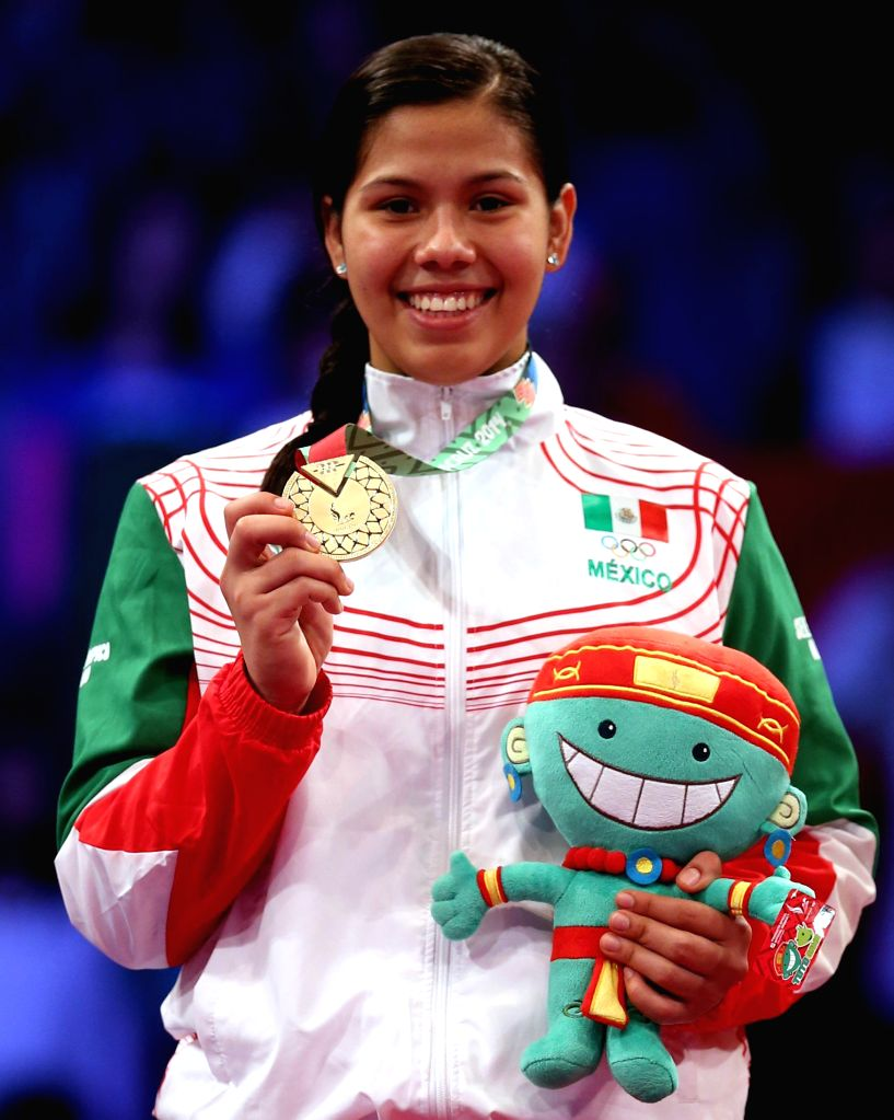 Veracruz (Mexico): Briseida Acosta of Mexico poses with the gold medal during the awarding ceremony of 73kg women's taekwondo competition during 2014 Veracruz Central American and Caribbean Games in .