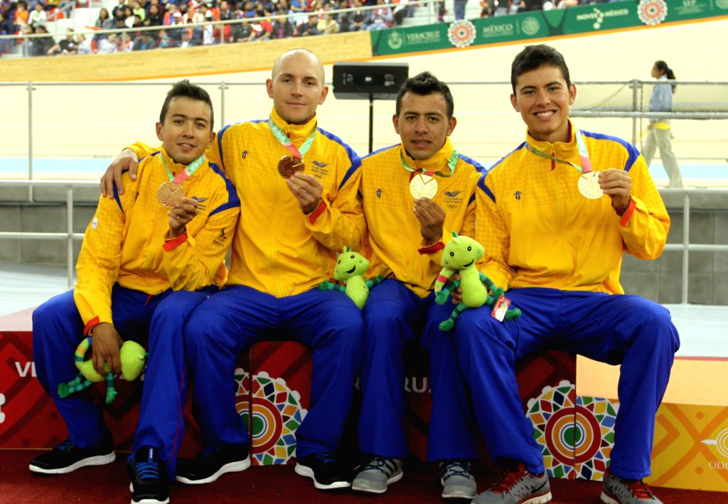 Veracruz (Mexico): Gold medalists (FROM L to R) Juan Esteban Arango, Weimar Roldan, Jordan Parray and Eduardo Estrada  of Colombia pose during the awarding ceremony of men's Team Pursuit of track ...