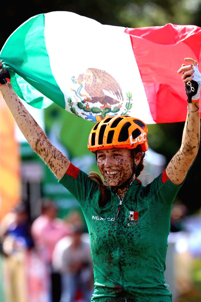 Mexico's Daniela Campusano Chavez holds a Mexican flag after her victory in the mountain cycling competition in the 2014 Veracruz Central American and Caribbean Games, in Xalapa, Veracruz, .