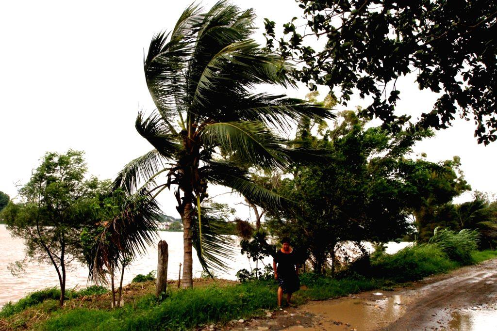 VERACRUZ, Sept. 9, 2017 - A woman walks near the sea before the arrival of hurricane Katia in Tecolutla of Veracruz State, Mexico, Sept. 8, 2017. Hurricane Katia intensified to Category 2 on Friday ...