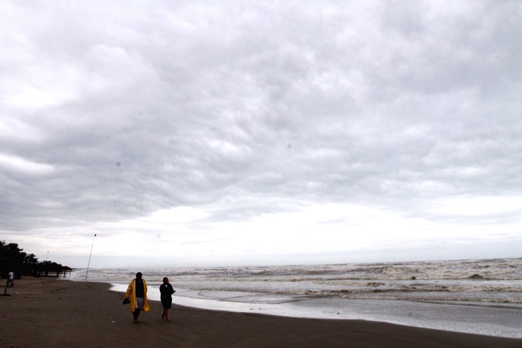 VERACRUZ, Sept. 9, 2017 - People walk on a beach before the arrival of hurricane Katia in Tecolutla of Veracruz State, Mexico, Sept. 8, 2017. Hurricane Katia intensified to Category 2 on Friday as it ...