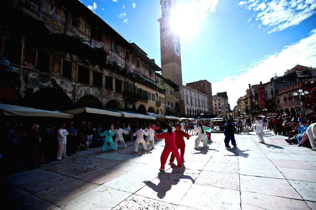 VERONA (ITALY), Sept. 18, 2016 Chinese performers play Taichi on the Market Square during Tocati in Verona of Italy, on Sept. 17, 2016. Artists from different places of China brought ...