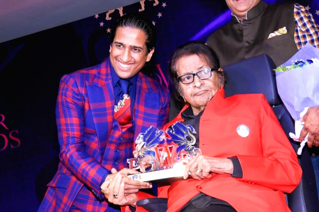 Veteran actor-filmmaker Manoj Kumar with author Arindam Chaudhuri. (File Photo: IANS) - Manoj Kumar