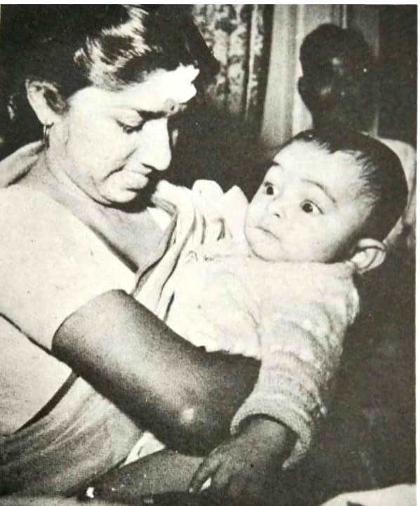 Veteran actor Rishi Kapoor on Tuesday walked down memory lane as he shared a throwback picture in which the legendary singer Lata Mangeshkar is seen cradling him in her arms when he was just an infant. - Rishi Kapoor