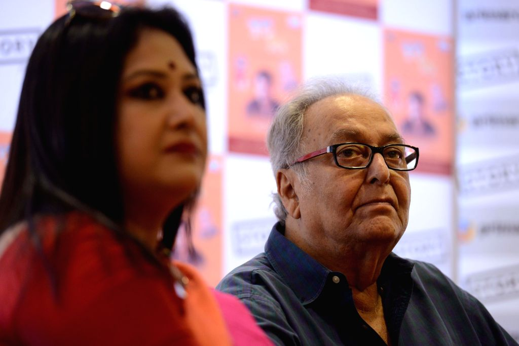 Veteran actor Soumitra Chatterjee and singer Riddhi Bandyopadhyay at the launch of 'Swapna Niye' in Kolkata on Aug 27, 2014. - Soumitra Chatterjee